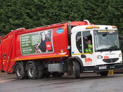Refuse collection vehicle demonstrating changeable graphics system.